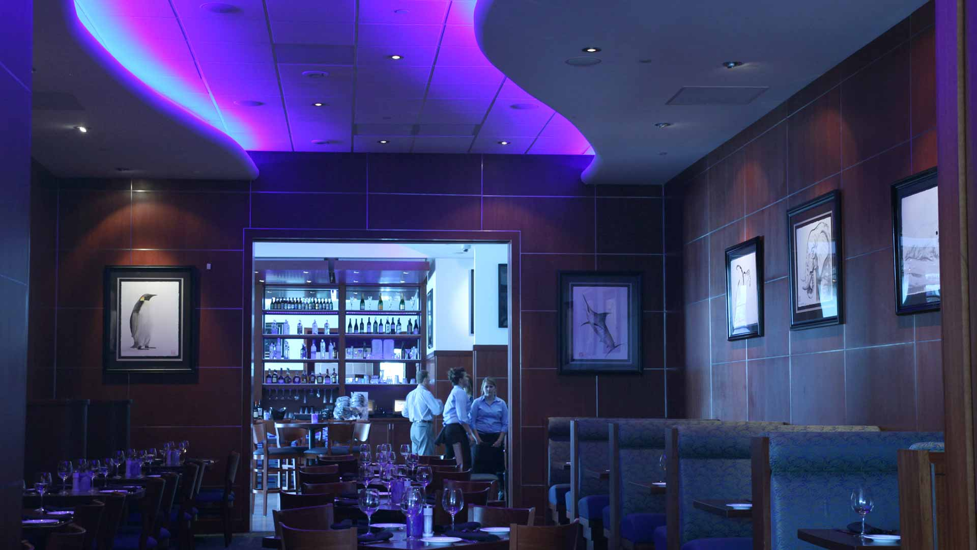 Photo of the VIP dining area in a restaurant with custom neon lighting.