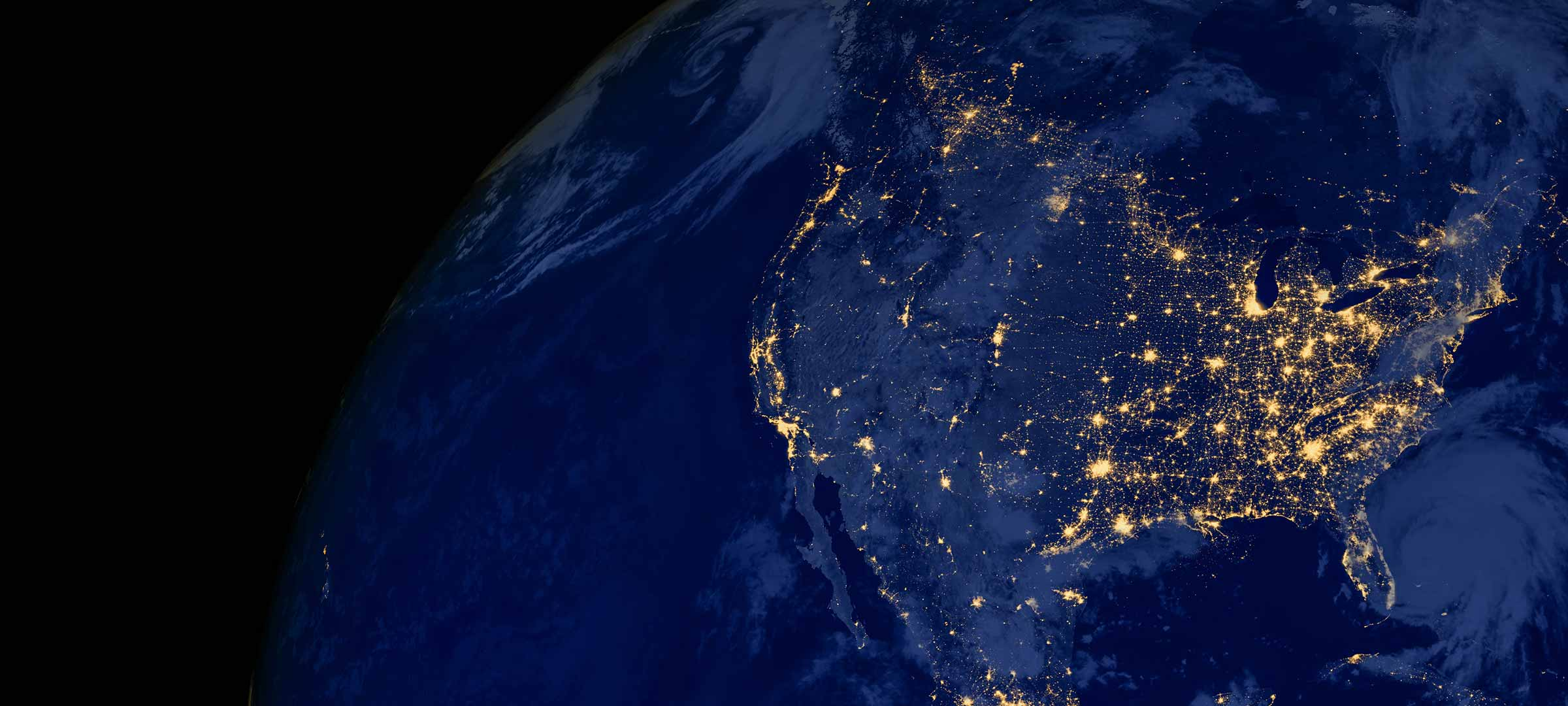 Image of the United States at night from space.